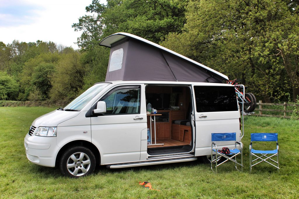 white-campervan-with-pop-top-roof
