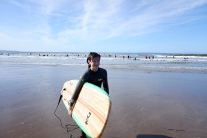 Young girl with surfboard in Croyde